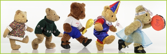 Photo of Melody Bear leading five bear friends in a musical parade