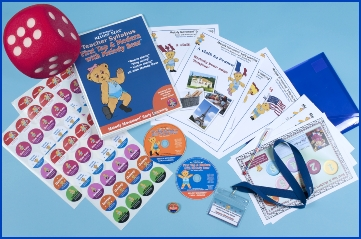 Photo of the First Tap & Modern reception age syllabus package with a file, big dice, CDs and dance teacher resources