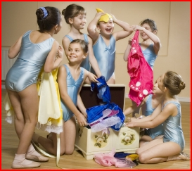 Photo of dancers looking for a costume in the dressing up box