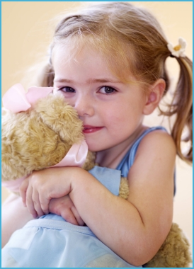 Photo of girl dancer age 3 hugging Melody Bear