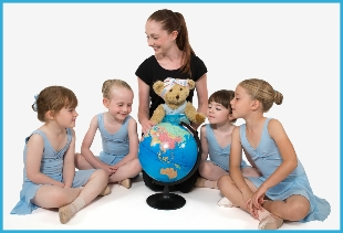 Melody Bear teacher with her students