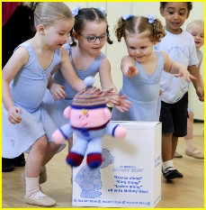 Photo of girls and boys dancing with Humpty Dumpty in a Little Bear Feet with Melody Bear class