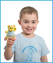 Young boy dancer with a Melody Bear finger puppet