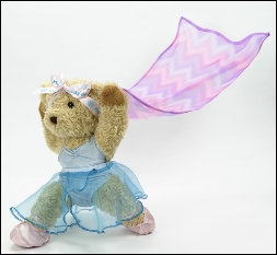 Melody Bear dances with a scarf