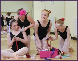 Photo of ballet students making headdresses