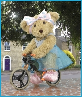 Melody Bear is on her bicycle