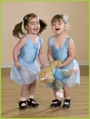 Photo of two girls tap dancing with Melody Bear in her Tip Tap Toe syllabus