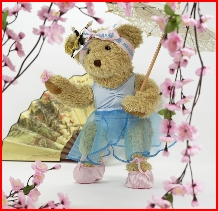 Melody Bear in her cherry blossom Japanese garden
