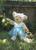 Photo of Melody Bear with a basket of apples