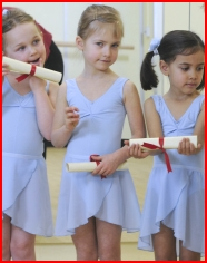 Girls receiving their Foundation Ballet Graduation certificates