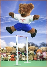 Photo of Milligan Bear jumping over a high jump