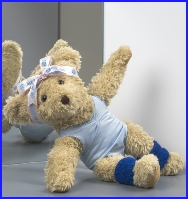 Photo of Melody Bear doing her jazz dancing wearing blue ankle warmers