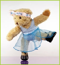 Photo of Melody Bear balancing in her tap shoes