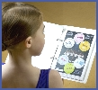 Junior Ballet dancer looks at her vocabulary stickers